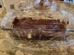 Plastic wrap on chocolate truffle mixture