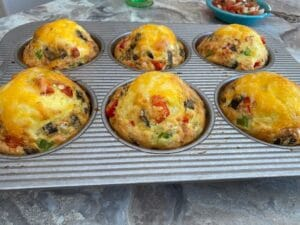 Omelets coming out of the oven with cheese