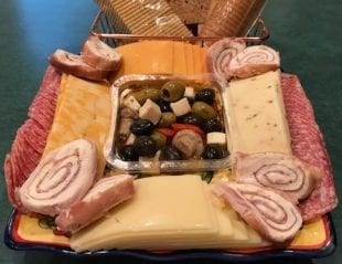 A meat and cheese charcuterie platter displays several tasty options